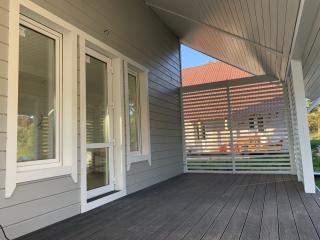 Каркасный дом по проекту КД 023 с террасой в комплектации «С отделкой + Инженерный пакет», в коттеджном поселке «Сосновские Озера 2»